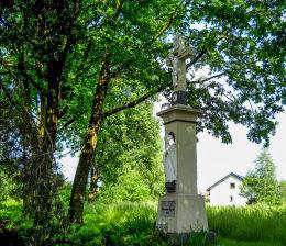 Przydrożny krzyż kamienny z kapliczką. Gostyń, gmina Wyry, powiat mikołowski.