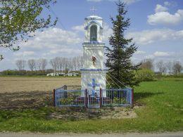 Przydrożna kapliczka słupowa świętego Wawrzyńca. Kunowo, gmina Łobżenica, powiat pilski.
